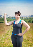Fitness beautiful plus size woman showing yes gesture Stock Photos