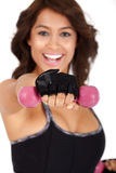 Fitness: Beautiful and very athletically fit woman curls dumbbells with a winning smile. Stock Photos