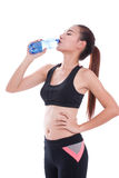 Fitness beautiful woman drinking water Stock Photography