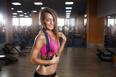 Fitness beautiful woman execute exercise with expander in gym Royalty Free Stock Images