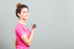 Fitness beautiful woman smiling and working out with dumbbell Stock Photography