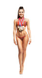 Fitness bikini athlete with winning medals Royalty Free Stock Photography