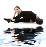 Fitness in black leotard on white sand #5 Royalty Free Stock Photography