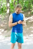Fitness blog. workout. Fitness app. Ui ux concept. gadget in modern sport. muscular man in fitness bracelet. sport app. On phone. digital sport. smart watch stock photos