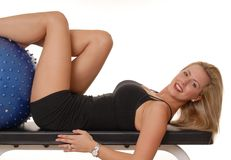 Fitness Blond 202. Beautiful young blond lady doing a fitness workout Royalty Free Stock Image