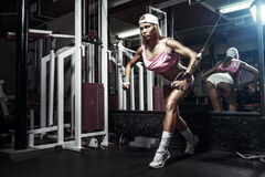 Fitness blonde woman exercising in gym Royalty Free Stock Images