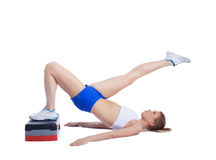 Fitness blonde woman with stepper Stock Photography