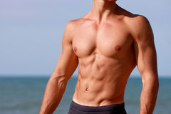 Fitness body abdominal with sea behind Stock Photography