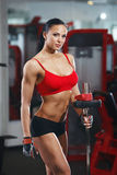 Fitness body girl with barbell in the gym Stock Photos