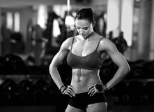 Fitness body girl in the gym Stock Image
