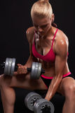 Fitness bodybuilder woman with dumbbells.beautiful blonde girl with muscles Royalty Free Stock Image