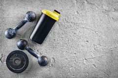 Fitness or bodybuilding background. Old iron dumbbells on conrete floor in the gym. Photograph taken from above, top. Fitness or bodybuilding concept background stock photo