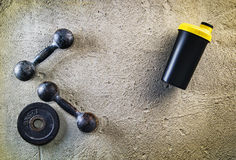 Fitness or bodybuilding background. Old iron dumbbells on conrete floor in the gym. Photograph taken from above, top Royalty Free Stock Photos