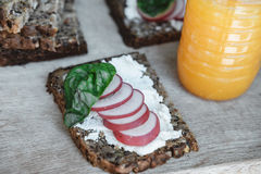 Fitness bread with cottage cheese, radish and basil and Orange j Stock Photo