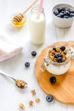 Fitness breakfast with granola, milk and honey on white background Stock Photography