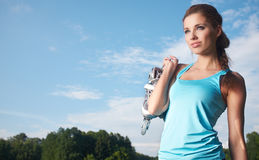 Fitness brunette posing outdoors in nature. Royalty Free Stock Photo