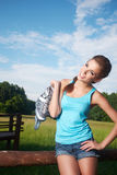 Fitness brunette posing outdoors in nature. Royalty Free Stock Photography