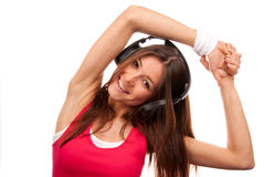 Fitness brunette woman listening music and smiling Royalty Free Stock Photo