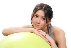 Fitness brunette yellow pilates ball  workout Royalty Free Stock Photos