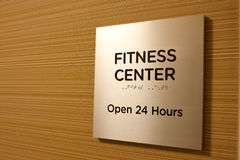 Fitness center. Gold metal sign Royalty Free Stock Photos