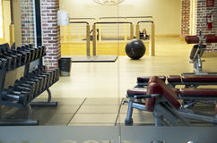 Fitness center gym room exercise equipments Stock Photo