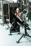 Fitness center senior woman exercise abs muscles Royalty Free Stock Photo