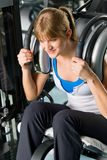 Fitness center young woman exercise abdominal Stock Image