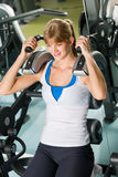 Fitness center young woman exercise abdominal Royalty Free Stock Images