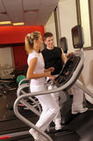 In fitness centre. The attractive woman and man training in fitness centre Royalty Free Stock Images