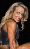 Fitness Champion Performs Her Stage Routine. Beautiful and buff Sharlin Maldonado performs her 2-minute indivudual routine in the Fitness finals of the 2016 NPC Stock Photos