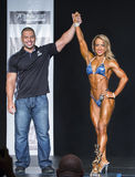 Fitness Champion Raises Arm in Victory Stock Images