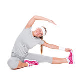 Fitness cheerful woman sitting Royalty Free Stock Images