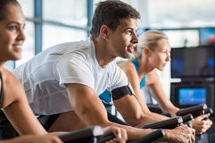 Fitness class biking at gym Royalty Free Stock Photos