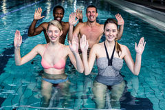 Fitness class doing aqua aerobics on exercise bikes Royalty Free Stock Photography