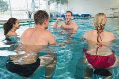 Fitness class doing aqua aerobics on exercise bikes Royalty Free Stock Photo