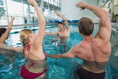 Fitness class doing aqua aerobics on exercise bikes Royalty Free Stock Photos