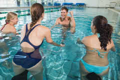 Fitness class doing aqua aerobics on exercise bikes Stock Images