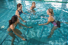 Fitness class doing aqua aerobics on exercise bikes Royalty Free Stock Image