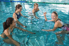Fitness class doing aqua aerobics on exercise bikes Stock Image