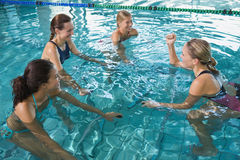 Fitness class doing aqua aerobics on exercise bikes Stock Photography