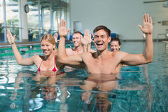 Fitness class doing aqua aerobics Royalty Free Stock Photography