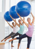 Fitness class doing pilates exercise with fitness balls Stock Photo