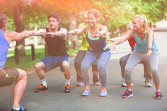 Fitness class doing squat sequence Royalty Free Stock Photo