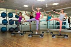 Fitness class doing step aerobics Royalty Free Stock Photos