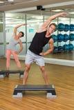 Fitness class doing step aerobics Stock Photos