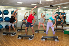 Fitness class doing step aerobics Royalty Free Stock Photos
