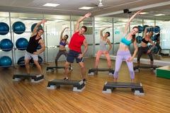 Fitness class doing step aerobics Stock Photo
