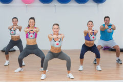 Fitness class exercising with kettlebells in gym Stock Image