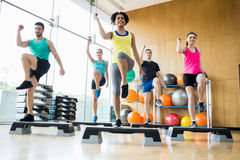 Fitness class exercising in the studio Stock Images