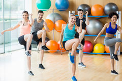 Fitness class exercising in the studio Stock Photo